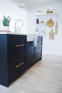 Silestone's Lyra quartz  A Modern, Black & White Miami Kitchen — Makeover | Apartment Therapy
