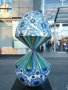 "Egg #222 is titled ""A glitch in reality"" and was designed by Faig Ahmed. I found it at Columbus Circle in front of the Time-Warner Building. It is the only egg that found that had a Passover theme. Last known auction price was $1,100."