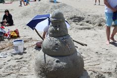 """The Savannah College of Art and Design held its annual Sand Arts Festival on May 6 on Tybee Island. Each year, students and alumni use sand and other materials found on the beach to craft sculptures that are then judged. In 2016, organizers tried to increase the amount of """"air sculptures"""" in the festival."""