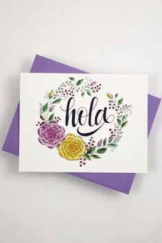 """Send a hello note to your Spanish speaking friend of family with this card that features my hand drawn, original lettering. ♥ DETAILS - s i z e : (1) card measuring approx. 4.25"""" x 5.5"""" (when folded)"""