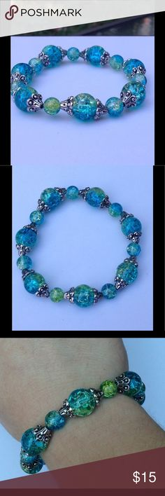 """Blue and Green Elastic Bracelet This lovely bracelet is made with sparkling blue and green duotone glass beads.  It is on elastic and will stretch to fit up to an 8"""" wrist.   Let me know if you need a different size!  All PeaceFrog jewelry items are made by me! Take a look through my boutique for coordinating jewelry and more unique creations. PeaceFrog Jewelry Bracelets"""