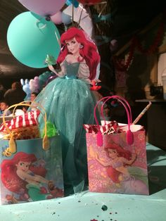 Little mermaid centerpiece top cut out of wood, and candy bags :)