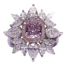 Fancy Pink Diamond Ring USA NEWAGE CT fancy purple pink diamond in the center surrounded by ct of marque and pear shape combination Pink Diamond Ring, Diamond Jewelry, Diamond Brooch, Halo Diamond, Gemstone Jewelry, I Love Jewelry, Fine Jewelry, Jewelry Rings, Purple Jewelry