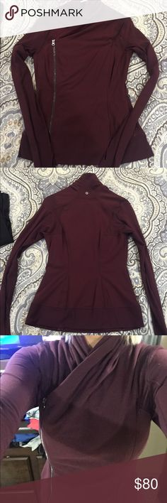Lululemon right-zip jacket Like-new maroon Lululemon right-sided zip jacket. Dual zippers, for extra layer of cozy warmth. Visible zipper is off-center to the right for stylish touch. Worn less than ten times, comes from a smoke free home and always ships fast. lululemon athletica Jackets & Coats