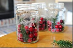 Christmas Candle holders - Mason jars were filled with votive candles, fake berries and spruce, and wrapped in a twine bow. Description from pinterest.com. I searched for this on bing.com/images