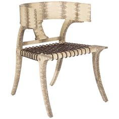 You know . . . just a simple Klismos chair.  Upholstered in lizard.  LOVE.