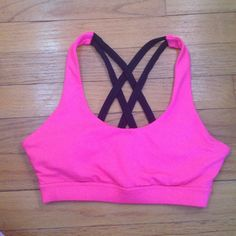 Cross Back Sport Bra This is such an adorable top!! Includes removable padding. In great condition with some fading on the tag. Forever 21 Tops