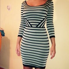 Striped Bebe Bodycon dress Light teal and black striped. In perfect condition. bebe Dresses Mini