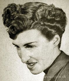 1950 parting fringe hairstyle    Short hair was given a side parting and smoothed through the top with curls through the sides and a small quiff     Hairstyle by: Harry Coleman