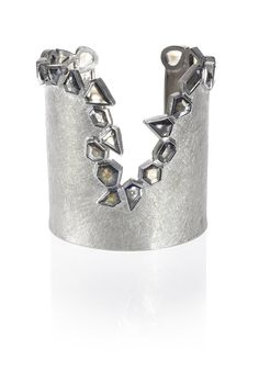 One of Todd's latest cuff designs. Faceted diamonds in palladium. http://blog.toddreed.com/into-the-void/