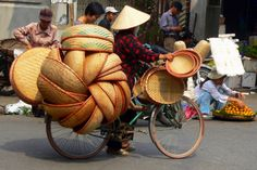Vietnam. Vietnamese women and how they carry all those baskets!