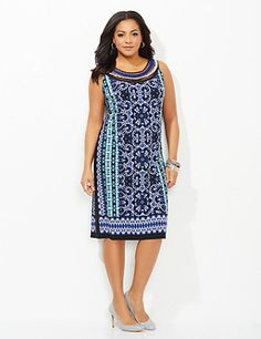 Our eclectic shift dress features vibrant hues and patterns inspired by the rich culture of the Amalfi Coast. Intricate swirls and dots cover the front and back while mesh, metallic and textured fabric decorate the neckline to create an accessorized look. Scoop neckline. Catherines plus size dresses are expertly designed to flatter your figure. catherines.com