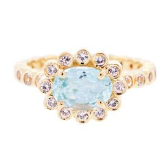 24k gold vermeil Grace setting with center oval cut aquamarine and surrounding white sapphires, $348, KiraKira