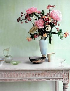 Light pink antiqued sofa table and roses. sigh
