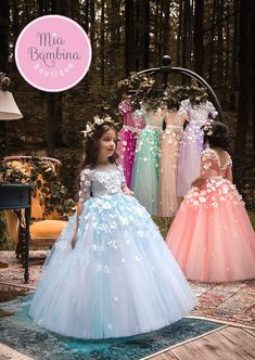 The Dominica Flower Girl Dress For Wedding by MB Boutique Canada. This is a satin flower girl dress with contrasting full tulle skirt. She will look adorable in this beautiful long tutu dress with its wide tulle contrasting skirt and triple rosette embellished waistline and bodice. Vest top bodice makes the dress to be a perfect summer girls dress for your little junior bridesmaid. Flowers overlay makes this dress a stunning toddler or pre-teen dress for any wedding, formal or special…