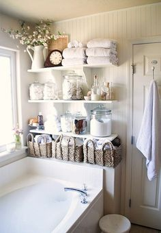 Install some budget-friendly shelves + fill them up with all your bathroom necessities.