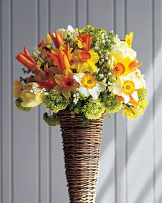 Daffodil Arrangement  Quail, Professor Einstein, and Delibes mix with tulips, viburnum, lily of the valley, and lady's mantle. Before putting daffodils with other flowers, change the water frequently until their toxic sap dissipates.