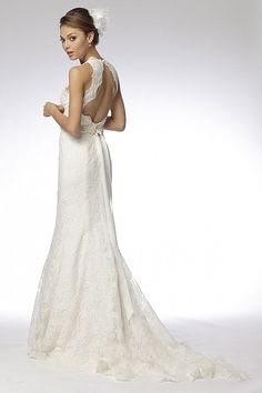 Ivory re-embroidered lace v-neck trumpet gown with keyhole back and pearl and crystal encrusted belt. Sweep train.