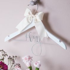 A beautiful, child-sized bespoke girls' clothes hanger, with wooden frame and hand-crafted wire work in the wording of your choice. This charming and unique personalised girls' clothes hanger provide. Personalized Wedding Guest Book, Wedding Hangers, Wedding Venue Inspiration, Christmas Gift Decorations, Space Wedding, Wedding Supplies, Engagement Couple, Wedding Planner, Wedding Venues