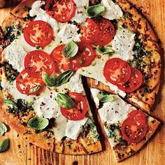Heating a cookie sheet in the oven before you put the pie on it gives you a crisper crust for this White Pizza with Tomato and Basil.