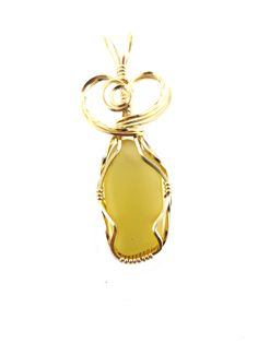 Yellow Sea glass pendant in 14k gold filled wire by LindysLane on Etsy