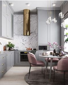 Luxe Glam style kitchen and dining room interior design with marble backsplash and crystal pendant lights