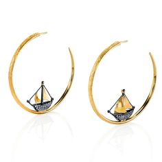 Arman Sarkisyan Ship Hoop earrings. Tiny baguette diamonds decorate the hull and there are billowing sails crafted in 22 carat gold. Discover the revival of the hoop earring and the fashionable way these jewellery brands are taking them forward: http://www.thejewelleryeditor.com/jewellery/top-5/top-5-hoop-earrings-spring-summer-2017/ #jewelry