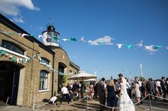 Sara Dalrymple Photography | Trinity Buoy Wharf London Wedding | Lace Mon Cheri Wedding Dress | Not any Morning Bridesmaid Dress Shop Green Gowns | DIY Decor