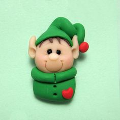 Polymer Clay Elf Holiday Pin by clayinaround on Etsy. Sweet!