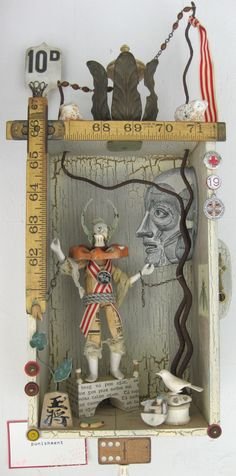 Art Assemblage by Jen Renzel -- I like the use of the metal wire going up through the top