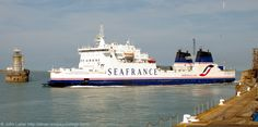 """MS Seafrance Nord Pas de Calais Freight Ferry, Western Entrance, Dover Harbour, Kent, England, UK. """"Nord Pas-de-Calais"""", now owned by MyFerryLink. Dover to Calais cross-English Channel route. Built 1987. Call Sign FNBN, IMO 8512152, MMSI 227011500. Also: Pride of Canterbury (PO Ferries), left of Dover Southern Breakwater West End Light (lighthouse). Admiralty Pier on right. 2010 Port of Dover English Channel, Ferry, Ship, Travel, Tourism and Vacation. See: http://www.panoramio.com/photo/38029852"""