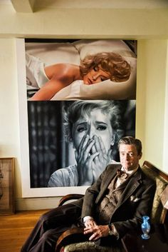 """Peter McGough, half of the time-bending art duo McDermott & McGough in an apartment of 1930's in the West Village. The painting by them on the wall, """"What Will I Tell My Heart?,"""" is from 2008 and is dated 1967. It shows Virna Lisi at top and Anne Francis at bottom."""