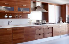 Long all-wood kitchen with white counter tops