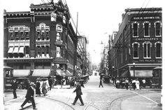 Looking east up Seventh from Market Street, 1916. The Live & Let Live Drug Company is on the left; the building is now known as the Central Block. Note the streetcar tracks and brick pavers in the center of the photo.