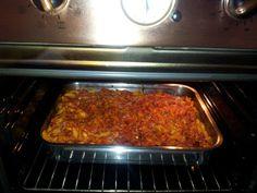 Pennete al forno con salame, mozzarella, ricotta, carne macinata e parmigiano