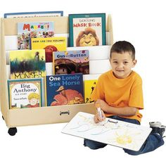 Jonti Craft 1 Sided Mobile Pick-A-Book Stand Paper-trays sold separately. Front side with four shelves. Backside provides display space and storage. Write-n-wipe partitions. Waiting Room Design, Waiting Rooms, Waiting Area, Preschool Furniture, Kids Furniture, Big Sea, Book Racks, Book Stands, Bookshelves