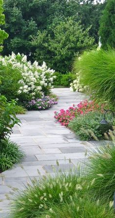 Grey marbled landscaped path...This is a well thought out landscape plan as it invites you to keeping walking along the meandering path.