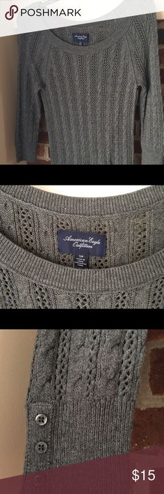 """American Eagle Boatneck Gray Sweater Sz S American Eagle Outfitters Women long sleeve boatneck dark gray sweater. 3 """"fake"""" small buttons at the edge of each sleeve. 55% cotton, 25% acrylic, 15% nylon, 5% wool. Very good condition, only worn a couple of times. American Eagle Outfitters Sweaters Crew & Scoop Necks"""