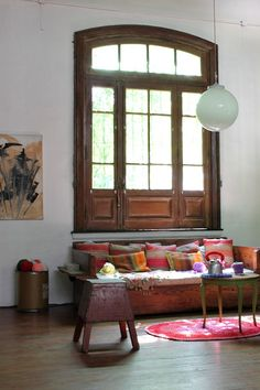 Pretty bohemian styled space. Lovely timber day bed with eclectic cushions.