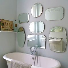 Decorating a bathroom wall with vintage mirrors adds instant bling to a plain bathroom. Here's how to create your own mirror wall.