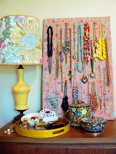A board covered in colorful fabric for pinning jewelry