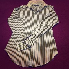 Ralph Lauren button down I wore this shirt once to work . It is practically brand new . No damages , stains etc. this is size 0and is true to size . Ralph Lauren Tops Button Down Shirts