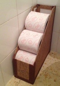 RV and travel trailer solution - use a magazine rack to store toilet paper