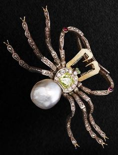 A coloured diamond, diamond and pearl spider brooch, circa 1890. The cushion-cut yellow diamond body mounted within a rose-cut diamond cluster surround, to a bouton-shaped pearl, with cabochon emerald eyes and textured gold pincers, the legs set throughout with rose-cut diamonds accented by two cabochon rubies, detachable fittings, pearl untested, yellow diamond weighs approximately 1.50 carats, mounted in silver and gold, French assay mark.