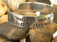 """Walking with a friend in the dark is better than walking alone in the light...I'm always amazed by people who overcome incredible odds to become exceptional people. Helen Keller is one of those people. This bracelet is stamped with a great quote from her. It reads """"Walking with a friend in the dark is better than walking alone in the light."""" This would be a great gift for that friend who is always right beside you even in your darkest times."""