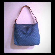 Dooney and Bourke bag Cotton; handles & trim: leather. Has a little pocket inside.  Adjustable single strap. Top zip closure blue signature print on it. The bag has a little wear on the side barely noticeable, very clean inside. Other than that it's in very good condition Dooney & Bourke Bags Hobos