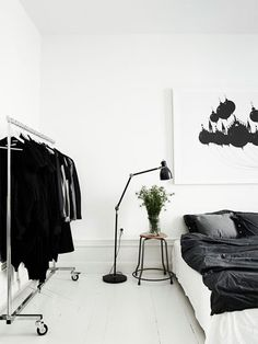 Black & white bedroom with open clothes storage. Photography by Pia Ulin.