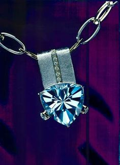 Pendant by Gary Dulac in White Gold and Diamonds Blue Topaz by John Dyer