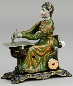 CAST IRON WOMAN AT SEWING MACHINE  Attributed to Sandt, Pat. numbers appear,a,casting, full figure of seated woman at sewing table, rear lever activates head and hand motions when turned and side of chair actually holds spool of string for sewing cloth items.