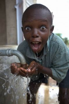 This makes me sad but happy at the same time-- the water looks fresh and clean for the kid but, other children in Africa have nothing.